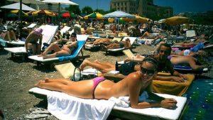 sunbathers-on-rhodes-beach-300x169