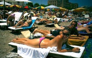 sunbathers-on-rhodes-beach-320x202