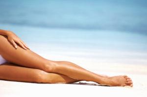 Luxuriant-legs-on-the-sand-iStock_000018798241XSmall-300x199