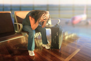 woman_stuck_in_airport_overbooking_flight_cancelled_680-300x200